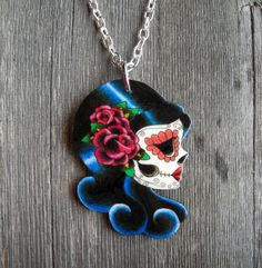 #Etsy #handmade #tattoo #sugar #skull #necklace $15.95  I am in love with this whole store on Etsy with lots of sugar skull and tattoo inspired jewelry