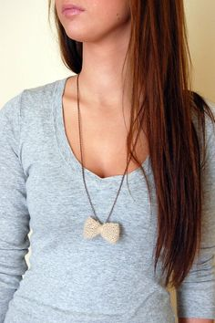 Great statement necklace. Love the combo of soft knitted yarn bow with chain necklace. $20