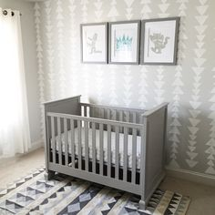 Max's grey nursery with sponge triangle stamped wall, where the wild things are frames, pottery barn Fiona crib and urban outfitters rug (on sale!)