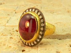 Cabochon ruby ring with silver crown and rose-cut diamonds