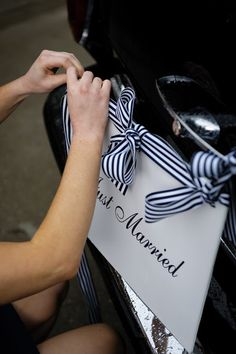Black and white striped ribbon looks great on this 'Just Married' sign. Black and white wedding inspiration.