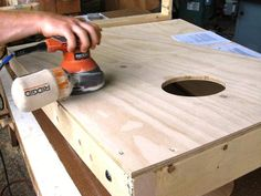How to Build a Regulation Cornhole Set: Sand the entire board and around all edges including inside the circle. Putty all screw holes. From DIYnetwork.com