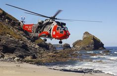 A Seaking Mk5 helicopter of 771 Naval Air Squadron conducts a Search and Rescue Exercise over the coast of Cornwall.