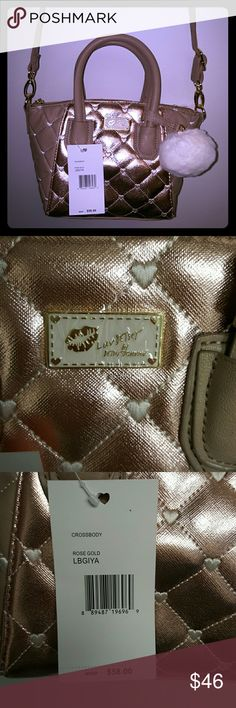 """🔥sale🔥Betsey Johnson rose gold cross body bag NWT Luv betsey quilted diamonds rose gold cross body bag  Measurement : 8""""L x 8""""H x 5""""W Bag is 10"""" across top 3"""" Hand drop 23"""" cross body strap Interior has one zipper compartment one slip pocket and 3 pen pockets Betsey Johnson Bags"""