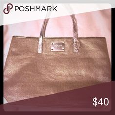 Michael Kors Brand-new never used Michael Kors tote that shiny silver accents bag Michael Kors Bags