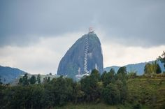 Re-Pin And CLICK The Image For More Pictures and Information on Christ the Redeemer in Guatape Rock in Colombia  http://www.canuckabroad.com/places/place/guatape-rock