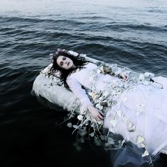 They gently laid the nymphs body on the water, white vines strewn across her.
