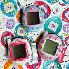 "Annie on Instagram: ""A #latergram of another berry Tamagotchi added to my collection, the Ciao version! Here it is pictured with my other ones.  #tamagotchi…"""