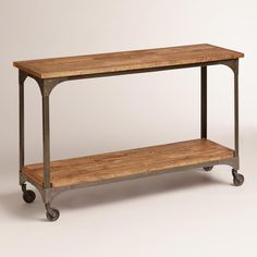 Topped with plants, books or picture frames, our console table gives your space a rustic, industrial feel with its mango wood surfaces and metal accents like locking caster wheels. >> #WorldMarket Dining Room