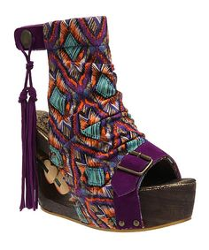 Not sure why, but I totally love These. Purple Woodstock Wedge by Irregular Choice