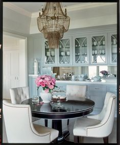 Jennifer Lopez's dining room - a gorgeous pedestal table and tufted upholstered chairs!