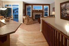 WestViews Builders | Highwood Villas | Calgary | KItchen/Living Room Living Room Kitchen, Mountain View, Calgary, Villas, Bungalow, Golf Courses, Deck, Luxury, Outdoor Decor