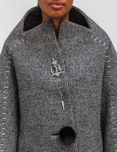 """Draw your sword. A classic houndstooth Cocoon coat is clasped with a """"Sword"""" depicting the founder's initials """"CB"""" in palladium-finished brass and rhinestone. """"Staple"""" embroidery at the sleeves is punctuated by a mink button closure. New Balenciaga, Clothes 2019, Diy Fashion, Fashion Design, Jacket Buttons, Cut And Style, Timeless Fashion, Coats For Women, Women Wear"""