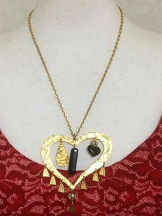 Vintage Christian Lacroix golden large heart necklace with dangling charms. 1940