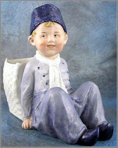 German Gebruder Heubach All-bisque Sitting Dutch Boy Figurine, c.1910