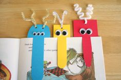 "monster bookmarks! pipe cleaners,  googley eyes, cardstock paper, glue, hole punch,  scissors.  Cut out a 3"" x 5 1/2"" rectangle out of cardstock paper. Cut out the nose w razor: 2 slices down the middle, finish off the rounded nose w scissors. Don't go all the way through, keep the nose flapping in the center. Glue the googley eyes on. Hole punch for the antennas & add pipe cleaners."