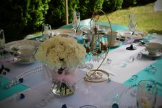 Breakfast at Tiffany's Inspired Bridal Shower: white carnation and chandelier centerpiece