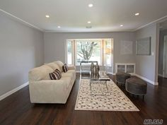3 walls this color of light grey and one wall dark Grey living room walls. Flooring & trim