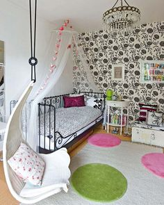 ♥ jmk says:- Pre-teen room. Adore the hanging swing seat from Ikea and love the colours. Black and white works well if mixed with some colours like pink and green to soften it and add interest.
