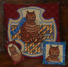A cat embroidered by Mary Queen of Scots, said to represent her cousin Elizabeth I.  Mary herself is represented by the mouse.