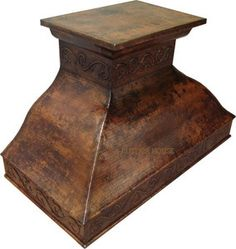 A hammered copper range hood injects a value-added ingredient to the kitchen decor. It is available in a wall mount and kitchen island version.