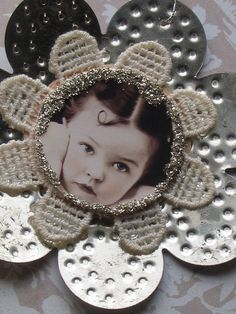 DIY photo flower Christmas ornament  Would also be cute for table markers at the table for a large family get together  Could also make a game of these by collecting several old photos, photocopying and using and see how many family members can identify the people in them Cute for table scatter too!