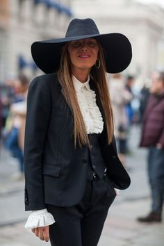 Anna Dello Russo takes a trip back to the 70s in Saint Laurent.   - HarpersBAZAAR.com