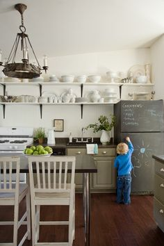 I want every parent to reconsider their stainless steel fridge purchase and do this instead. What fun!