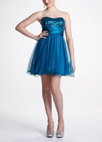 Flashy, fierce and fun are only three words to describe this striking sequin dress! Sparkling sequin strapless bodice is sure to light up any dance floor on prom night. Banded empire waist creates a stunning silhouette. Vivid short tulle skirt makes dancing all night a breeze. Fully lined. Back zip. Imported polyester. Dry clean. Also available in plus sizes as Style X2409WTKA.A popular neckline for brides seeking a stylish and versatile look (offering unlimited jewelry and accessory…
