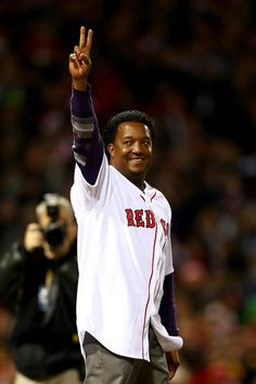 Former Boston Red Sox player Pedro Martinez waves to the crowd before throwing out a ceremonial first pitch prior to Game Two of the 2013 World Series at Fenway Park on Oct. 24, 2013.