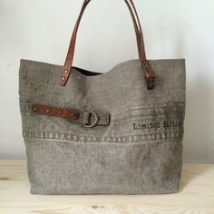 Image of Little Cabas Kaki Handmade Handbags & Accessories - -Image of Little Cabas Kaki tote bag. This site has so many unique bags, totes, purses made from anything and everything.gray upcycled canvas tote bag with leather handlesupcycled drop clot Sacs Tote Bags, Tote Purse, Tote Handbags, Canvas Tote Bags, Reusable Tote Bags, Diy Sac, Denim Purse, Boho Bags, Linen Bag