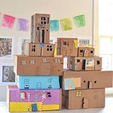 the kids are building a cardboard box apartment building in art class. we will keep adding to it next week. can't wait to see how it evolves! #artbarclass #recycled