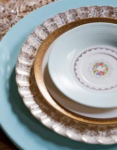 A stack of elegant vintage plates via Mismatched China / Wedding Style Inspiration / LANE (instagram: the_lane)    #TheLANEweddings  #BulgariResortBaliEscape