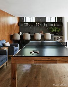 Tour A Century-Old Home Transformed For A Modern Family A handsome Ping-Pong ta. Tour A Century-Old Home Transformed For A Modern Family A handsome Ping-Pong table further signals Garage Game Rooms, Game Room Basement, Cozy Basement, Ping Pong Room, Ping Pong Table, Ping Pong Bar, Bar Pub, Small Game Rooms, Pool Table Room