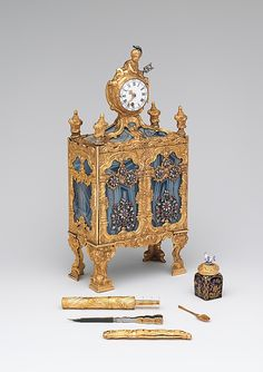 Nécessaire incorporating a watch (one of a pair)  John Barbot  (English, recorded 1751–65)  Date: ca. 1760 Culture: English, London Medium: Gold, agate, rubies, diamonds