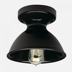 """""""Fixtures from Portland, Oregon-based Schoolhouse Electric provide a stylish, vintage look. The Alabax Surface fixture is available in black or white porcelain and is $135."""""""