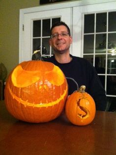 "Submitted by Steve Bercel (Fall 2015) -- The dollar sign is the symbol of money and how everything in economics revolves around money. I tried to do a supply of labor graph with wages on the y axis and employees on the x axis and an elastic curve in photo 2. I added a third greedy pumpkin (Jack Skellington from ""Nightmare Before Christmas"" by Tim Burton) with the money pumpkin to demonstrate the reality of economics in today's business enviroment.   PS. My wife helped carve Jack Skellington."