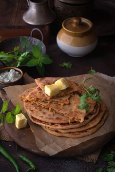 Mooli Ke Parathe is an utterly delicious Indian bread stuffed with spicy mooli (radish) filling and then cooked on flat griddle. It is,then shallow fried either wth ghee or oil and even butter. Serve this ultimate Punjabi Mooli Ke Parathe with some curd and pickle on the side. Best Recipe you will ever need.