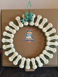 Give your dog a special treat this Christmas with a Bonio Advent/Christmas wreath.  Complete with box.