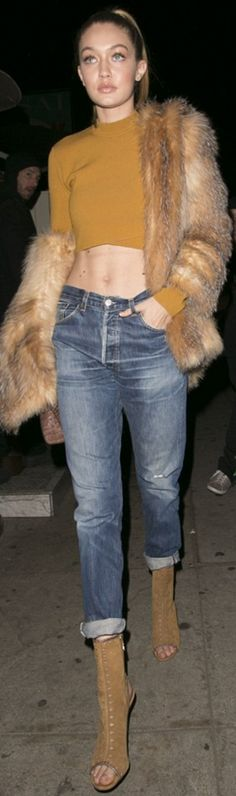 Who made Gigi Hadid's tan coat, yellow cropped sweater, brown handbag, jeans, and tan boots?
