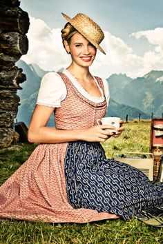 This is a Dirndl dress designed by modern designer Lenal Poschek. It is not a traditional Dirndl dress but it is definitely inspired by one and I wanted to keep this source as a reference.