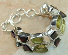 Lemon Quartz, Garnet Faceted  bracelet designed and created by Sizzling Silver. Please visit  www.sizzlingsilver.com. Product code: BR- 7654