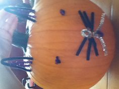 Instead of carving your pumpkin use pipe cleaners to decorate it. Mine is a cat:-)