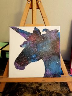 Unicorn head silhouette acrylic painting.