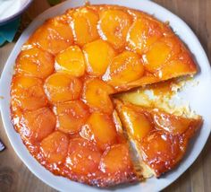 Raymond LeBlanc French Tarte Tatin 300g all-butter puff pastry plain flour, for dusting 6 dessert apples  (about 900g/2lb), such as Braeburn, Cox's Orange Pippin or Adam's Pearmain 100g golden caster sugar 85g unsalted butter (60g/2¼oz chilled and diced, 25g/1oz melted) crème fraîche (full-fat please!) or high-quality vanilla ice cream, to serve