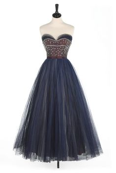 Lot 120 - A Jacques Heim couture beaded tulle ball gown, circa 1955, labelled,                                                                                                                                                      More