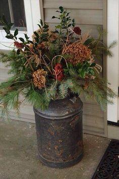 Christmas foliage in a milk churn