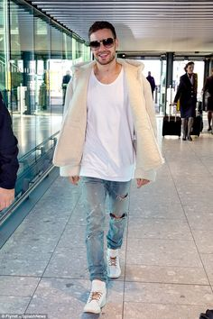 Busy: For Liam Payne it was time to resume the promo trail for his new single Bedroom Floor, as he was spotted catches a flight from London's Heathrow Airport to Los Angeles on Monday