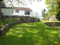 Good example of how curved timber retaining walls allow sinuous shapes with an organic material. Steep Gardens, Small Gardens, Landscape Architecture, Landscape Design, Garden Design, Trampolines, Garden Retaining Wall, Retaining Walls, Sloped Yard