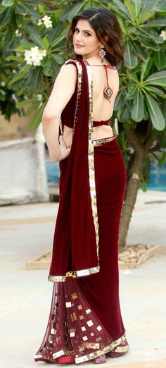 Zarine Khan wears a maroon sari from designer Archana Kocchar for a jewellery launch.